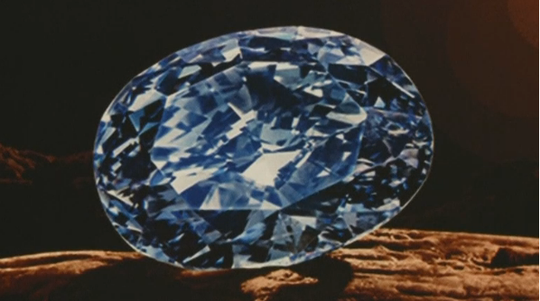 The largest oval fancy vivid blue diamond ever to appear at an auction shattered Asia's jewelry auction record in Hong Kong on Tuesday (April 5) evening.(photo grabbed from Reuters video)