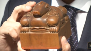 "A seal described by Sotheby's as ""the most important Chinese historical object ever offered at an auction"" goes under the hammer for $11.8 million.(photo grabbed from Reuters video)"