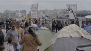 Greeks gathered to show support for refugees in the port city of Piraeus in April.(Photo grabbed from Reuters video)