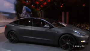 Tesla Chief Executive Elon Musk unveils a prototype of the Model 3 car to group of Tesla owners in California.(photo grabbed from Reuters video)