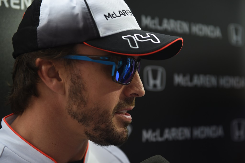 McLaren Honda's Spanish driver Fernando Alonso speaks during a briefing after his medical check ahead of the Formula One Chinese Grand Prix in Shanghai on April 14, 2016. / AFP PHOTO / GREG BAKER