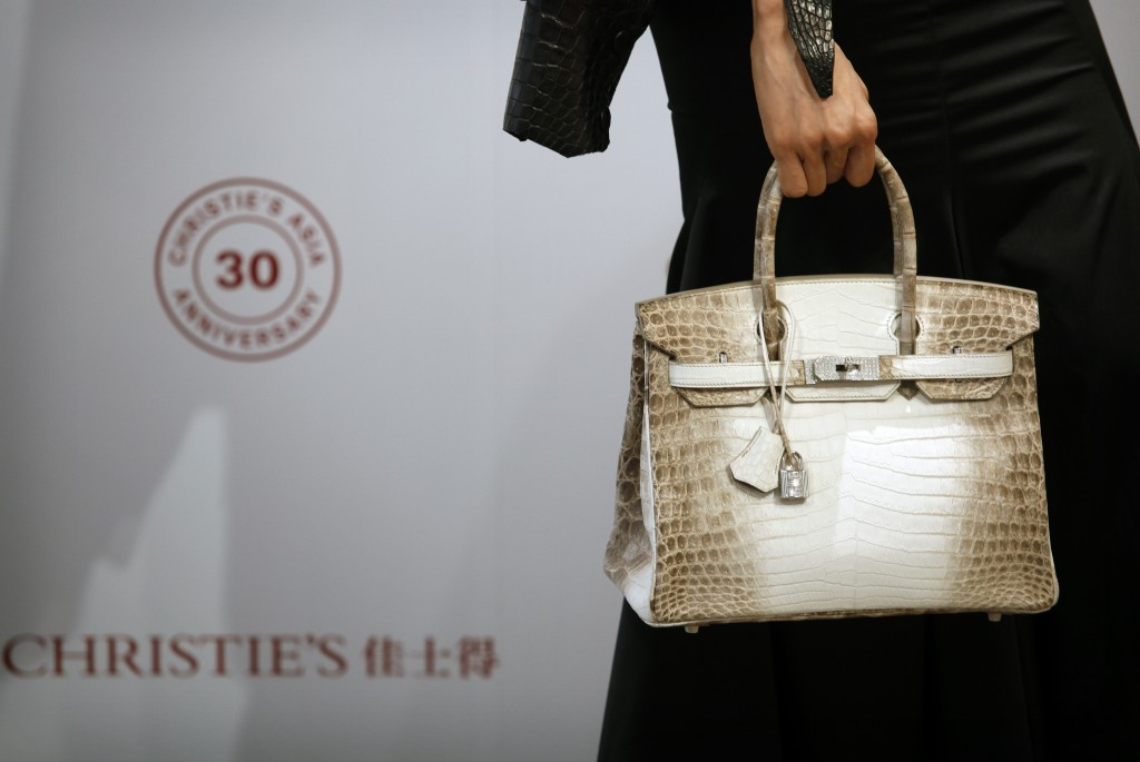 d0c011c265c4 Eunis Chan models a Matte White Himalaya Niloticus Crocodile Diamond Birkin  with 18K gold and diamond