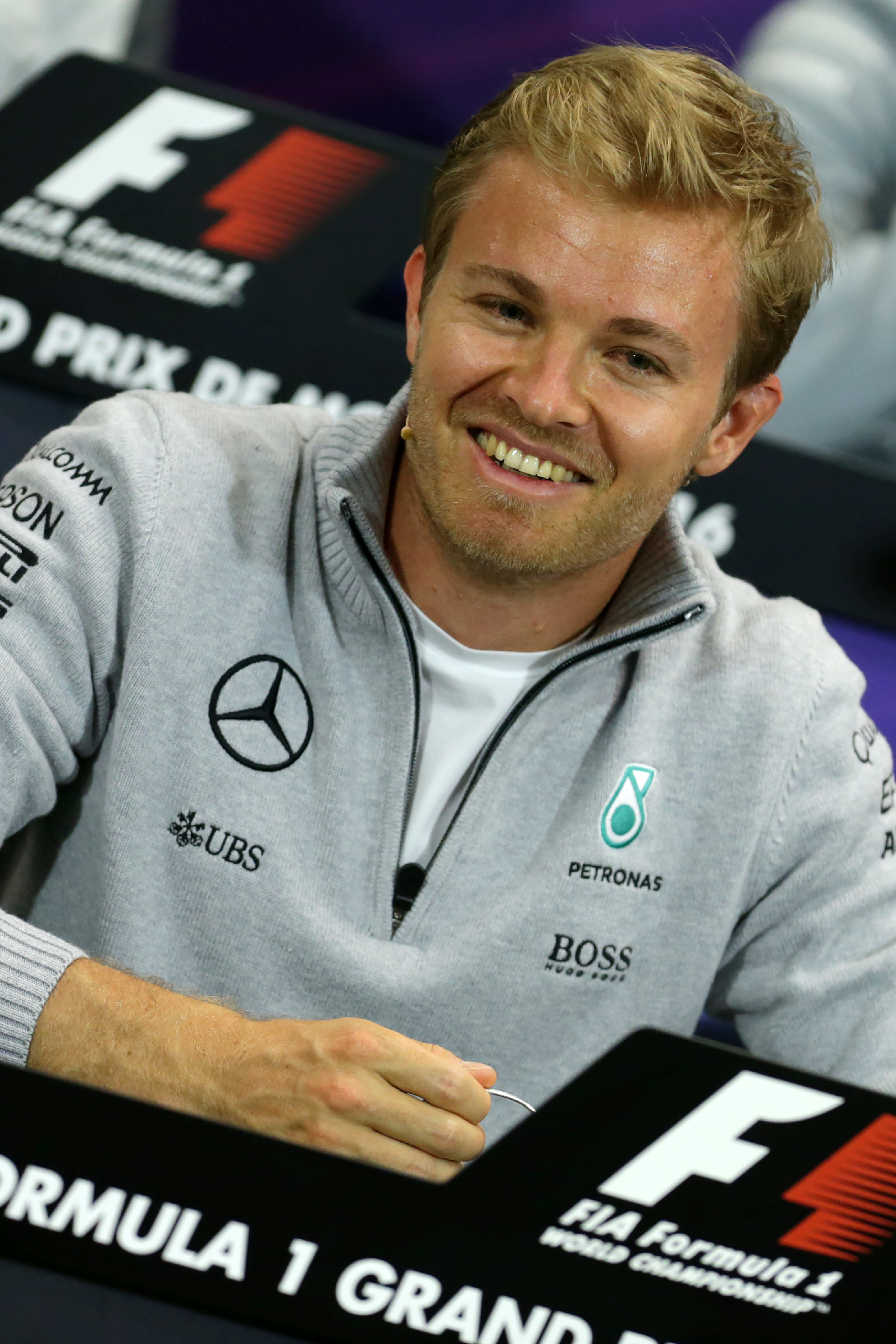 Mercedes' German driver Nico Rosberg smiles during a press conference at the Monaco street circuit in Monte-Carlo on May 25, 2016, four days ahead of the Monaco Formula One Grand Prix. / AFP PHOTO / Jean-Christophe MAGNENET