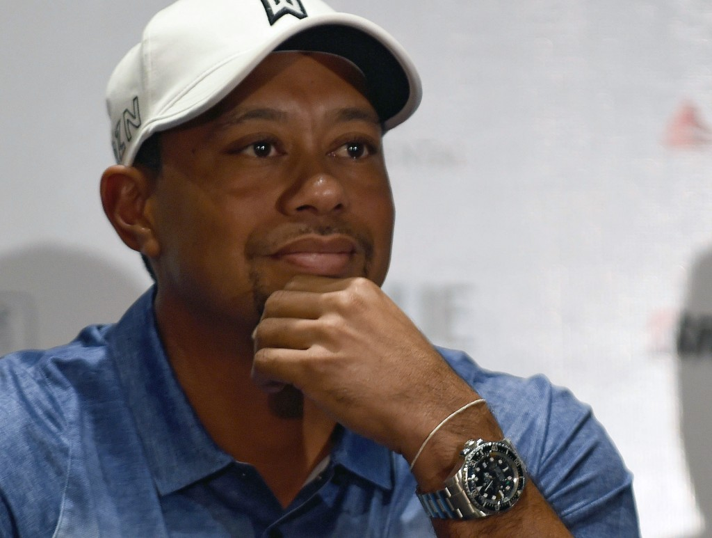 US golfer Tiger Woods attends a press conference at the Presidente Interncontinental Hotel in Mexico City on October 20, 2015. Woods is in Mexico to promote the Bridgestone America's Golf Cup. AFP PHOTO/ALFREDO ESTRELLA / AFP PHOTO / ALFREDO ESTRELLA