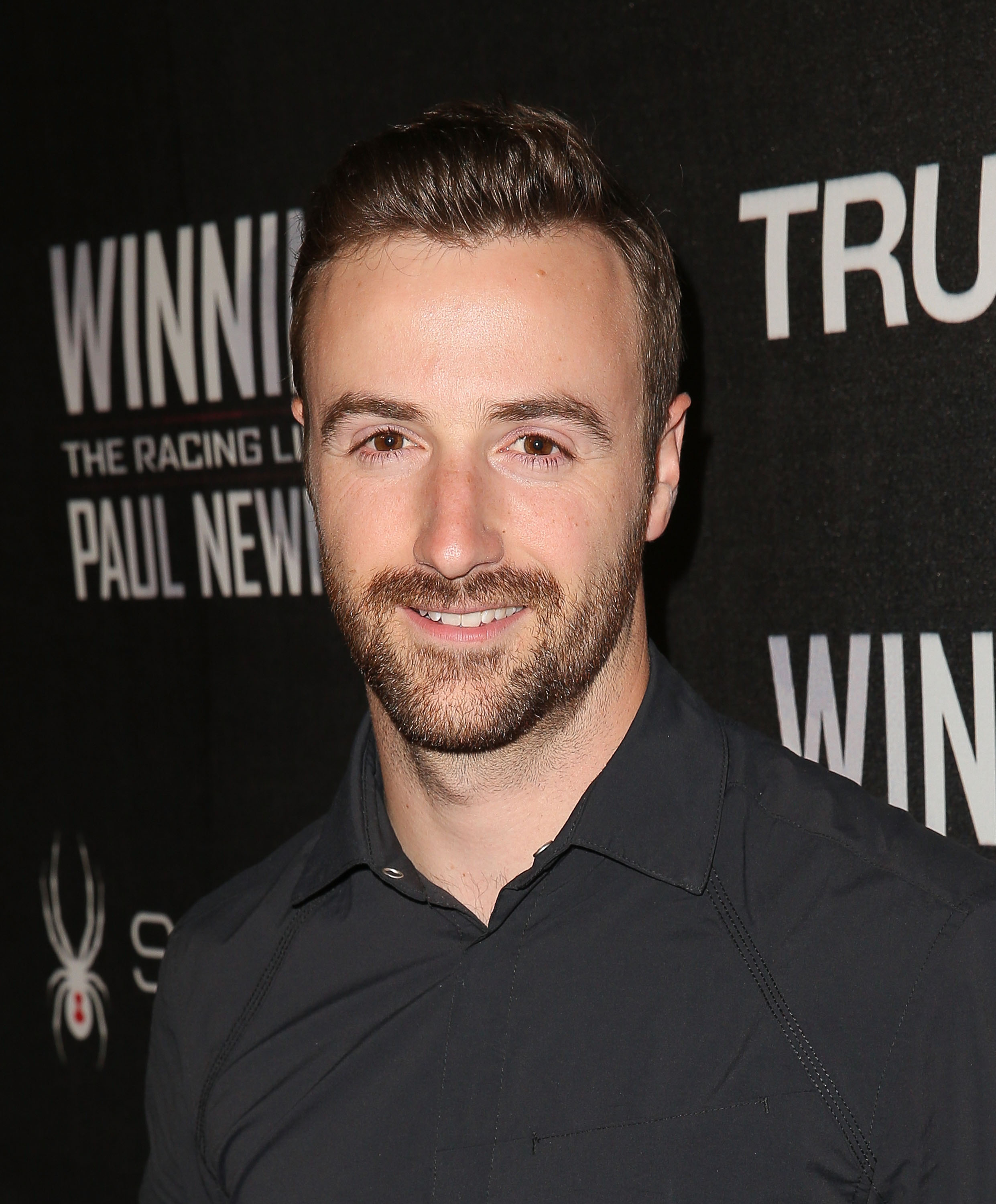 HOLLYWOOD, CA - APRIL 16: Professional racing driver James Hinchcliffe attends the charity screening of 'WINNING: The Racing Life Of Paul Newman' at the El Capitan Theatre on April 16, 2015 in Hollywood, California.   Imeh Akpanudosen/Getty Images/AFP