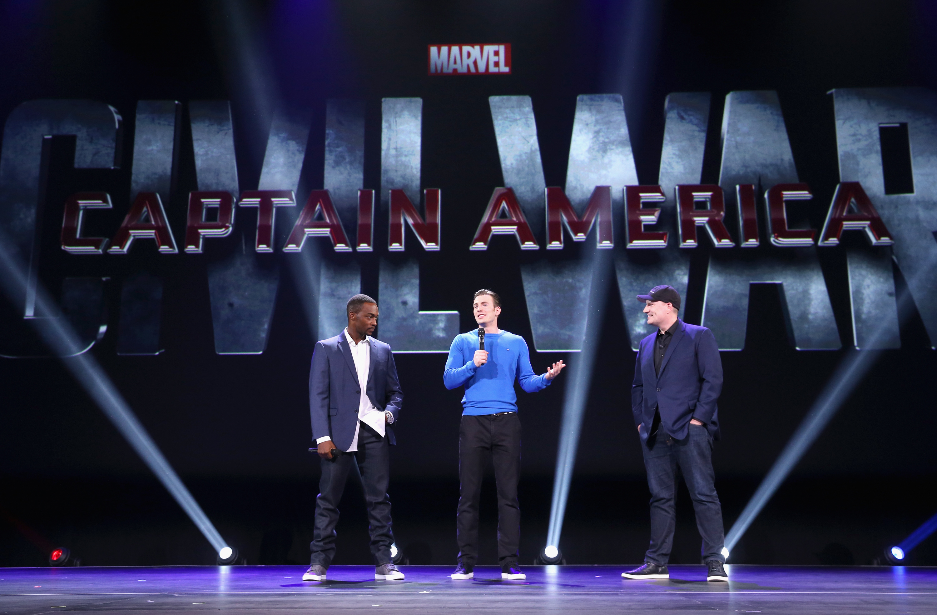 """ANAHEIM, CA - AUGUST 15: (L-R) Actors Anthony Mackie, Chris Evans and Producer Kevin Feige of CAPTAIN AMERICA: CIVIL WAR took part today in """"Worlds, Galaxies, and Universes: Live Action at The Walt Disney Studios"""" presentation at Disney's D23 EXPO 2015 in Anaheim, Calif.   Jesse Grant/Getty Images for Disney/AFP"""
