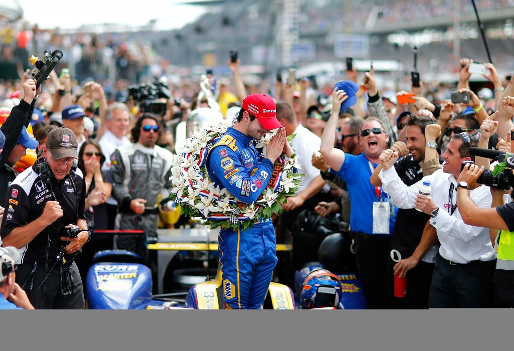 INDIANAPOLIS, IN - MAY 29: Alexander Rossi, driver of the #98 Andretti Herta Autosport Napa Dallara Honda celebrates in victory circle after winning the 100th Running of the Indianapolis 500 Mile Race at Indianapolis Motorspeedway on May 29, 2016 in Indianapolis, Indiana.   Jonathan Ferrey/Getty Images/AFP