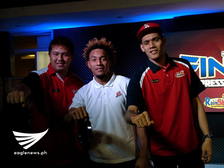 Rain or Shine forward Beau Belga (left) and Raymond Almazan (right) poses for photos with Alaska Aces forward Calvin Abueva during the PBA Commissioner's Cup press conference at the PBA Cafe Metrowalk. (Photo courtesy: Diego de la Paz / Sports On Air, Eagle News Service)