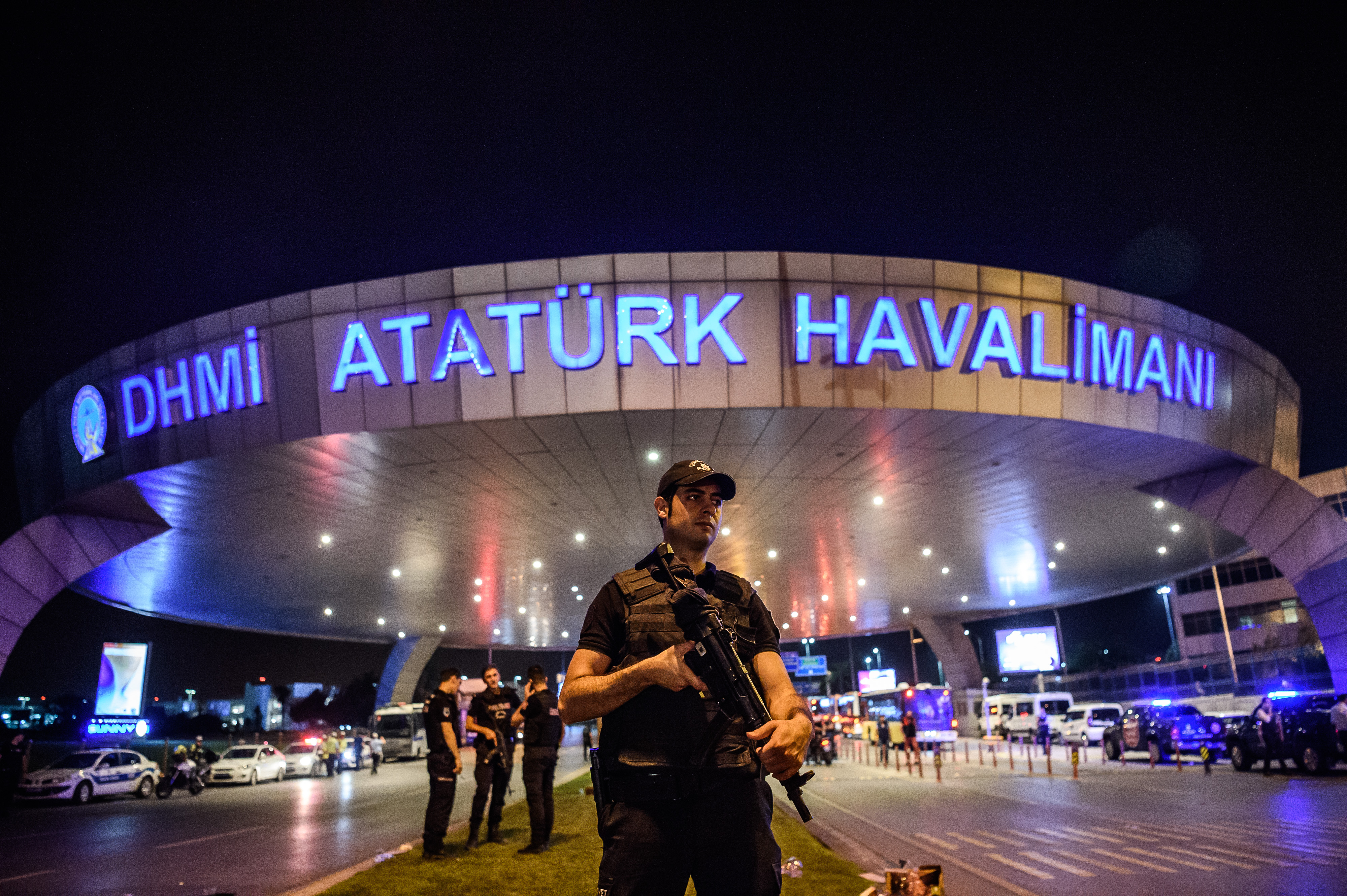 A Turkish riot police officer patrols Ataturk airport`s main enterance in Istanbul, on June 28, 2016, after two explosions followed by gunfire hit Turkey's largest airport, killing at least 10 people and injuring 20.  All flights at Istanbul's Ataturk international airport were suspended on June 28, 2016 after a suicide attack left at least 36 people dead.  / AFP PHOTO / OZAN KOSE