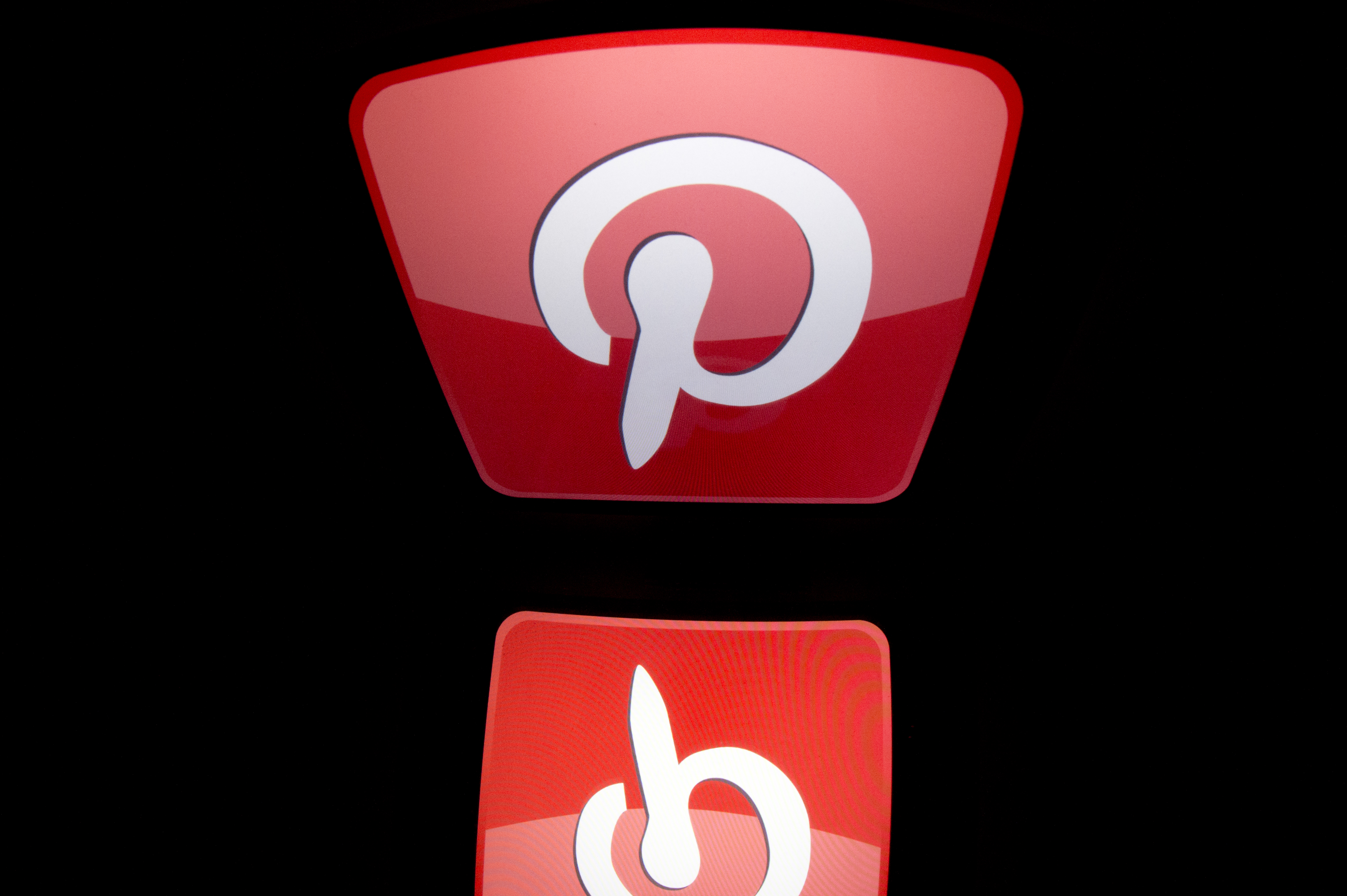 """The logo of mobile app """"Pinterest"""" is displayed on a tablet on January 2, 2014 in Paris.  AFP PHOTO / LIONEL BONAVENTURE / AFP PHOTO / LIONEL BONAVENTURE"""
