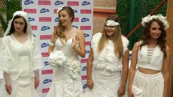 Toliet paper is transformed into winning designs at the 12th Annual Toilet Paper Wedding Dress Contest in New York.(photo grabbed from Reuters video)