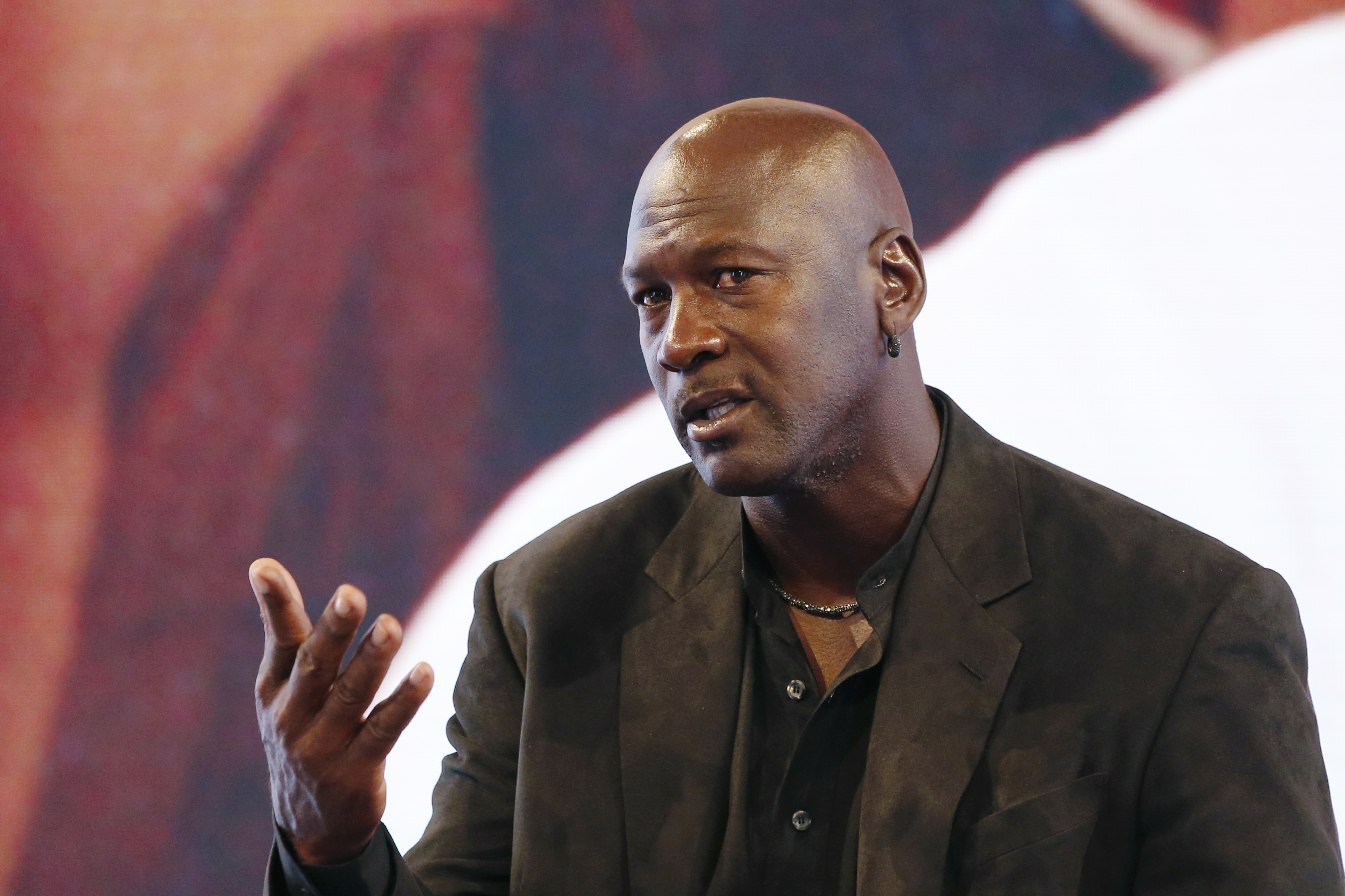 Former professional US basketball player Michael Jordan delivers a press conference at the Palais de Tokyo in Paris on June 12, 2015 to present Palais 23, an event at the Palais de Tokyo from June 12 to 14 to celebrate the 30th anniversary of Jordan Brand.  AFP PHOTO / PATRICK KOVARIK / AFP PHOTO / PATRICK KOVARIK