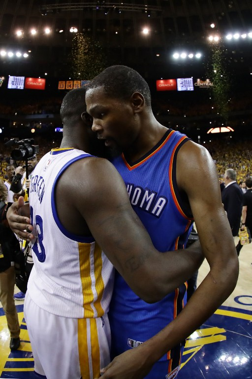 OAKLAND, CA - MAY 30: Kevin Durant #35 of the Oklahoma City Thunder hugs Draymond Green #23 of the Golden State Warriors after losing 96-88 in Game Seven of the Western Conference Finals during the 2016 NBA Playoffs at ORACLE Arena on May 30, 2016 in Oakland, California. NOTE TO USER: User expressly acknowledges and agrees that, by downloading and or using this photograph, User is consenting to the terms and conditions of the Getty Images License Agreement.   Ezra Shaw/Getty Images/AFP