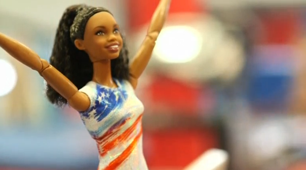Olympic gymnast Gabby Douglas gets a Barbie doll created in her likeness. (Photo captured from Reuters video)