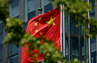The Chinese national flag is seen on a flagpole in Beijing on August 8, 2016.  Most of the five stars on the Chinese flags being used at medal ceremonies at the Rio Olympics are misaligned, officials said, prompting a diplomatic protest and online fury. / AFP PHOTO / STR