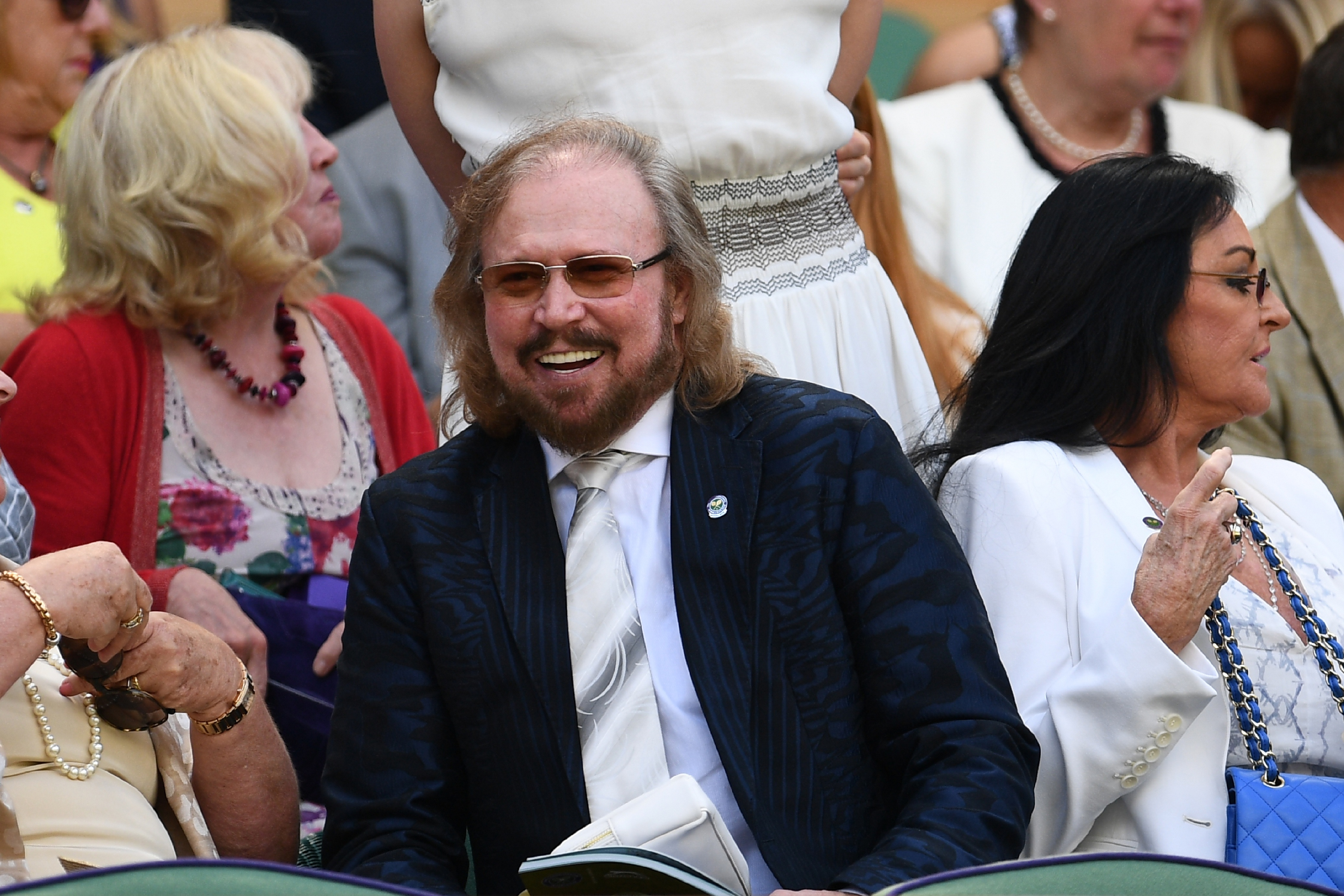 Barry Gibb, only surviving member of the Bee Gees watches the women's semi-final match on the eleventh day of the 2016 Wimbledon Championships at The All England Lawn Tennis Club in Wimbledon, southwest London, on July 7, 2016. / AFP PHOTO / GLYN KIRK / RESTRICTED TO EDITORIAL USE