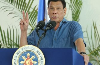(File Photo)  Philippine President Rodrigo Duterte gestures as he delivers his speech prior to departing for a visit to Brunei and China at Davao airport on October 16, 2016.  President Duterte will be leaving today for Lima, Peru for the APEC Leaders' Summit where he is expected to meeti with Russian President Vladimir Putin. / AFP PHOTO / MANMAN DEJETO