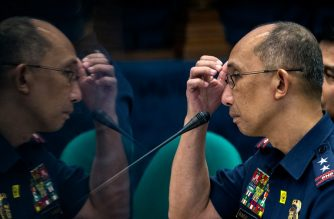 "A reflection of Philippine National Police (PNP) deputy chief for operations Benjamin Magalong is seen on a pillar as he answers questions during the senate hearing into the death of Albuera Mayor Rolando Espinosa in Manila on November 10, 2016. Espinosa, who President Rodrigo Duterte named as being involved in the illegal drug trade, was shot dead in jail on November 5, police said, the second local official implicated in narcotics to be killed in two weeks. / AFP PHOTO / NOEL CELIS / ""The erroneous mention[s] appearing in the metadata of this photo by NOEL CELIS has been modified in AFP systems in the following manner: [adds information in caption regarding reflection in image]. Please immediately remove the erroneous mention[s] from all your online services and delete it (them) from your servers. If you have been authorized by AFP to distribute it (them) to third parties, please ensure that the same actions are carried out by them. Failure to promptly comply with these instructions will entail liability on your part for any continued or post notification usage. Therefore we thank you very much for all your attention and prompt action. We are sorry for the inconvenience this notification may cause and remain at your disposal for any further information you may require."""