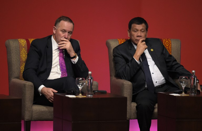 New Zealand's Prime Minister John Key (L) and Philippines' President Rodrigo Duterte (R) take part in the start of the ABAC and APEC Leaders' Dialogue at the Asia-Pacific Economic Cooperation Summit in Lima on November 19, 2016. Pacific Rim leaders are meeting in Peru on November 19-20 to push for continued free trade against the backdrop of rising protectionism globally.  / AFP PHOTO / Rodrigo BUENDIA