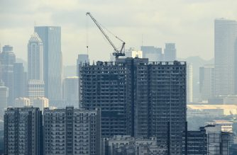 A bird's eye view of a building under construction in Manila on November 17, 2016. The Philippines became developing Asia's fastest-growing major economy in President Rodrigo Duterte's first three months in office, officials said on November 17, even as his fiery rhetoric hit the peso and stock prices. / AFP PHOTO / TED ALJIBE