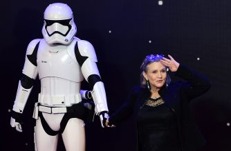 "(FILES) In this file photo taken on December 16, 2015, US actress Carrie Fisher poses with a storm trooper as she attends the opening of the European Premiere of ""Star Wars: The Force Awakens"" in central London. The late actress Carrie Fisher, who played Princess Leia in Star Wars films, will appear posthumously in the final installment of the latest trilogy in the series, the film's director JJ Abrams revealed Friday, April 12, 2019. The name of the last episode in the 42-year-old Skywalker saga was also revealed -- ""The Rise of Skywalker"" -- along with a first look at a teaser trailer for the highly-anticipated film.  / AFP PHOTO / LEON NEAL"