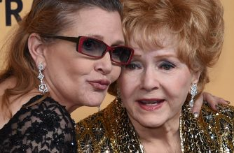 (FILES) This file photo taken on January 24, 2015 shows Debbie Reynolds (R), recipient of the Screen Actors Guild Life Achievement Award, and her daughter Carrie Fisher posing in the press room during the 21st Annual Screen Actors Guild Awards at The Shrine Auditorium  in Los Angeles, California.    Film legend Debbie Reynolds died on December 28, 2016 after suffering a stroke, a day after the death of her movie star daughter Carrie Fisher, US media reported. / AFP PHOTO / GETTY IMAGES NORTH AMERICA / Ethan Miller