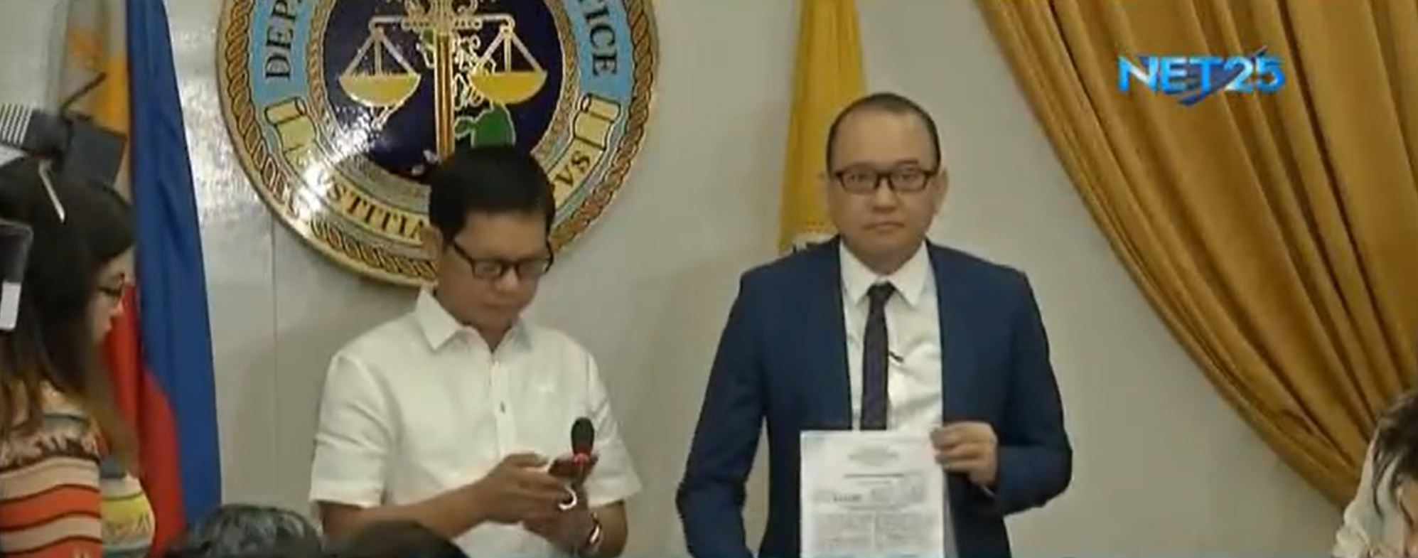 The two immigration deputy commissioners who are now in hot water, Michael Robles and Al Argosino.  (Eagle News Service)