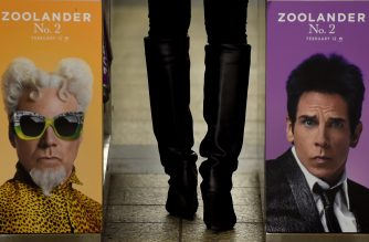 """(FILES) This file photo taken on February 25, 2016 shows a woman passing through a turnstile in the New York City Subway with a advertisment for """"Zoolander No. 2"""" featuring Ben Stiller (R) and Will Ferrell. """"Zoolander,"""" and """"Batman v Superman"""" topped nominations announced  January 23, 2017 for the Razzies, Hollywood's anti-awards celebrating the worst films of 2016. Leading the list is """"Zoolander No. 2."""" -- """"the 15-years-too-late sequel"""" -- with nine nominations including for worst picture, worst actor (Ben Stiller) and worst supporting actress (Kristen Wiig).  / AFP PHOTO / Timothy A. CLARY"""