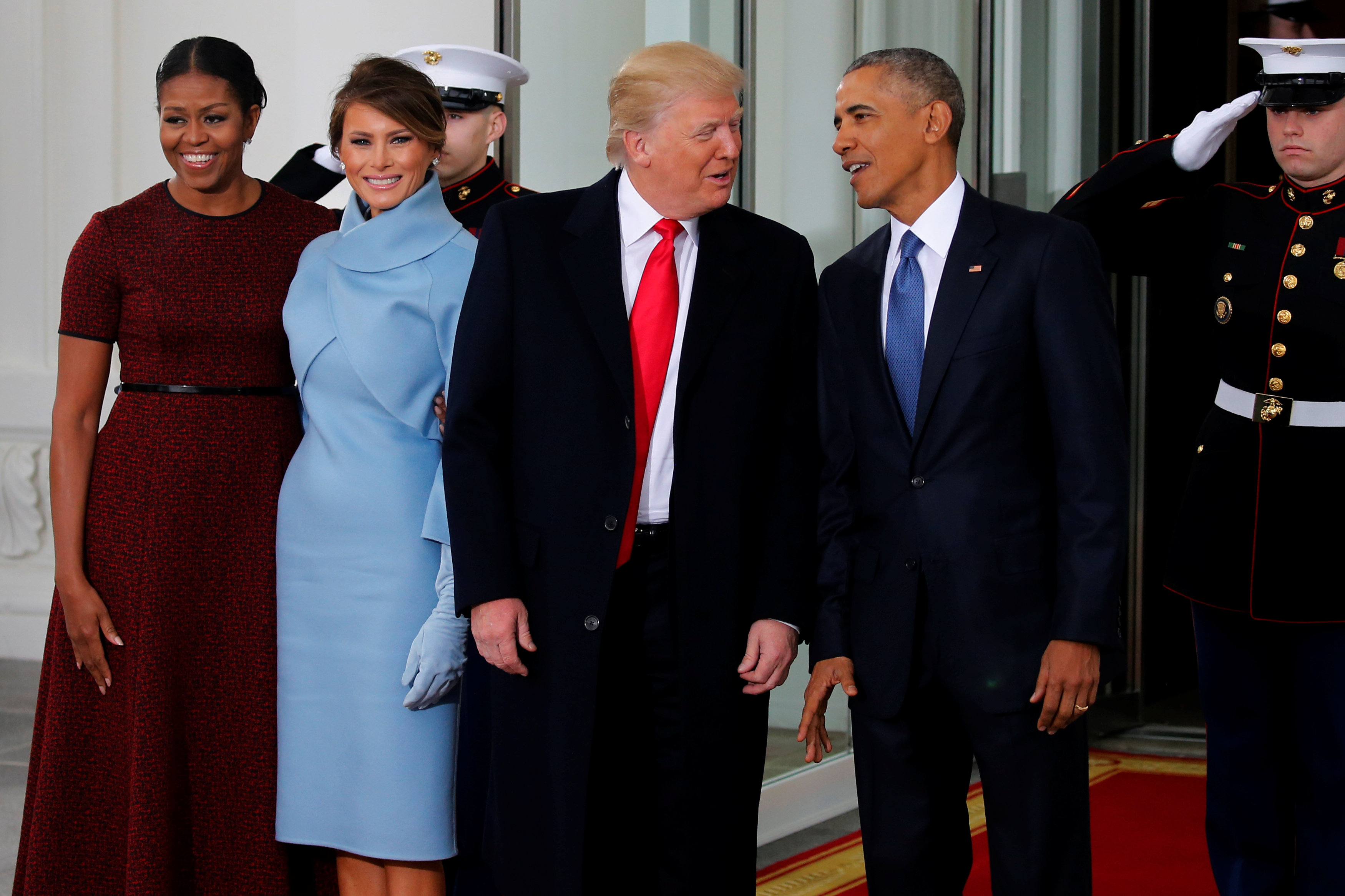 Former U.S. President Barack Obama (R) and former first lady Michelle Obama (L) greet then U.S. President-elect Donald Trump and his wife Melania for tea before the inauguration at the White House in Washington, U.S. January 20, 2017. REUTERS/Jonathan Ernst