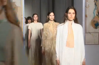 Valentino designer Pierpaolo Piccioli presents his first solo haute couture collection in Paris, showcasing a dreamy Spring/Summer 2017 line. (Photo grabbed from Reuters video)