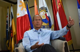 """Philippine Defence Secretary Delfin Lorenzana takes part in an interview with AFP at the defence offices in Manila on February 7, 2017. Manila expects China to try to build on a reef off the coast of the Philippines, the country's defence secretary said February 7, adding this would be """"unacceptable"""" in the flashpoint waterway. / AFP PHOTO / TED ALJIBE"""