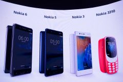 "New phone models by Nokia are displayed on a screen during the presentation of the new models ""Nokia 6"", ""Nokia 5"", ""Nokia 3"" and ""Nokia 3310"" during a press conference on February 26, 2017 in Barcelona on the eve of the start of the Mobile World Congress. Phone makers will seek to seduce new buyers with even smarter Internet-connected watches and other wireless gadgets as they wrestle for dominance at the world's biggest mobile fair starting tomorrow.  / AFP PHOTO / Josep Lago"