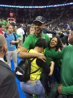 Tyler Dorsey celebrates with his family after Oregon defeats Kansas in the Midwest Regional Final. Dorsey finished with a game-high 27 points.