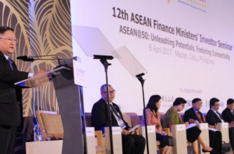 Finance chief Cesar Dominguez explains why this is the best time to invest in the ASEAN region.  The region's 10 member-economies take center stage in this year's 12th session of the ASEAN Finance Ministers Investors Seminar (AFMIS) in Cebu City.  (Photo from DOF website)