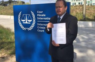 Atty. Jude Sabio at the International Criminal Court in The Hague, Netherlands. He is holding the 77-page complaint he filed against President Rodrigo Duterte and other former and current government officials/ Office of Senator Antonio Trillanes IV/