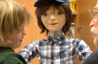 A humanoid robot called Kaspar has been designed to engage specifically with children with autism, helping them to interact and communicate with adults and other children.(photo grabbed from Reuters video)