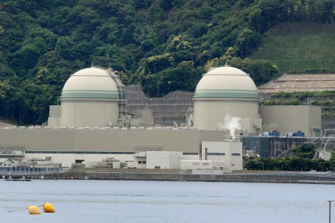 This picture shows the No 4 reactor (R) of the Kansai Electric Power Takahama nuclear plant in Fukui Prefecture on May 17, 2017. A Japanese utility on May 17 switched on a nuclear reactor, the latest to come back in service despite deep public opposition in the aftermath of the Fukushima crisis. / AFP PHOTO / JIJI PRESS / STR / Japan OUT