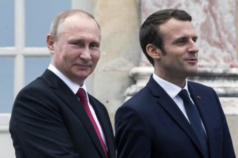 French President Emmanuel Macron (R) and his Russian counterpart President Vladimir Putin visit an exhibition about Russian emperor Peter the Great at the Grand Trianon following their meeting at the Versailles Palace, near Paris, on May 29, 2017. Macron hosts Russian counterpart Vladimir Putin in their first meeting since he came to office with differences on Ukraine and Syria clearly visible. / AFP PHOTO / POOL / Etienne LAURENT