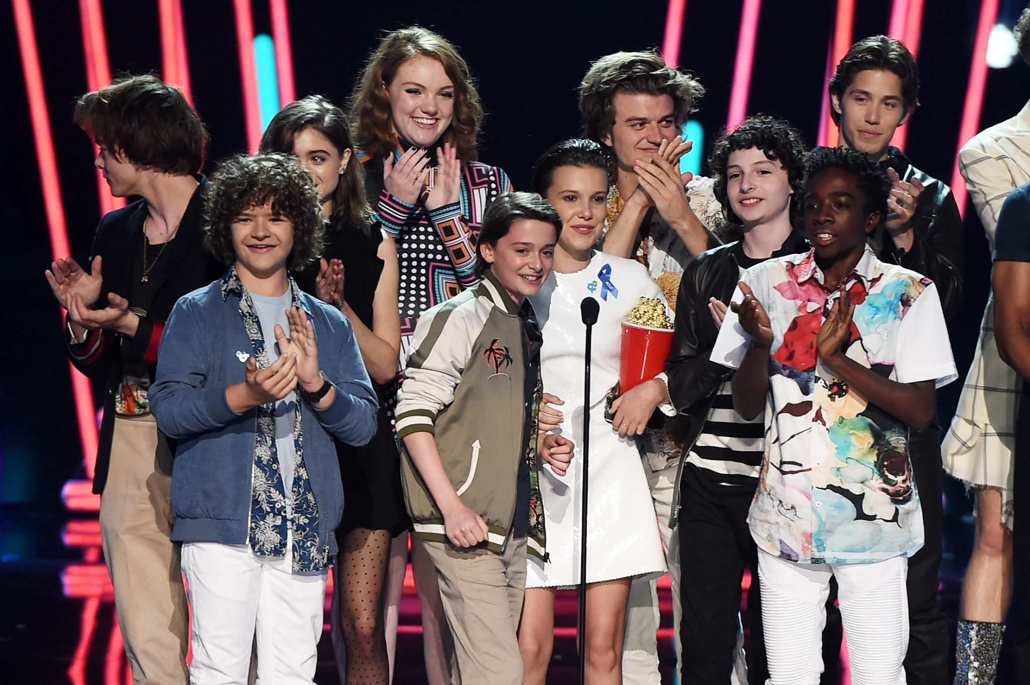 LOS ANGELES, CA - MAY 07: The cast of 'Stranger Things' accepts Show of the Year onstage during the 2017 MTV Movie And TV Awards at The Shrine Auditorium on May 7, 2017 in Los Angeles, California. Kevin Winter/Getty Images/AFP