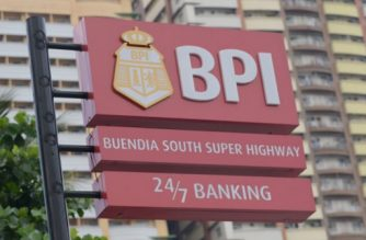 A logo of Bank of the Philippine Islands (BPI) is seen in Manila on June 7, 2017. A wave of unauthorised transactions have hit a major Philippine bank, triggering fears of hacking even as company officials said on June 7 it was an internal computer error. / AFP PHOTO / TED ALJIBE