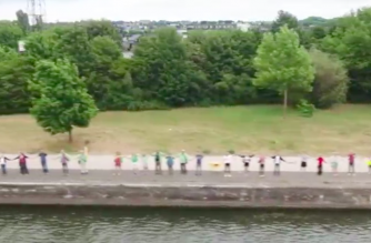 Thousands of protesters formed a human chain on Sunday (June 25) to demand the closure of two Belgian nuclear reactors, Tihange and Doel. Photo grabbed from Reuters video file.