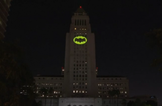 The late actor Adam West was honored by the city of Los Angeles on Thursday with a ceremonial lighting of the iconic Bat-Signal onto the City Hall building.(photo grabbed from Reuters video)