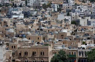 A picture taken on June 29, 2017 shows a view of the houses in the old town of the divided city of Hebron in the southern West Bank. On July 7, 2017 UNESCO declared in a secret ballot the Old City of Hebron in the occupied West Bank a protected heritage site. Hebron is home to more than 200,000 Palestinians, and a few hundred Israeli settlers who live in a heavily fortified enclave near the site known to Muslims as the Ibrahimi Mosque and to Jews as the Cave of the Patriarchs. / AFP PHOTO / HAZEM BADER