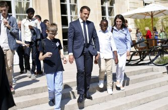 France's President Emmanuel Macron (C) welcomes autistic children prior to the launching of a program to enhance the diagnosis and treatment of autism on July 6, 2017 at the Elysee Palace in Paris.  The program to enhance the diagnosis and treatment of autism was launched on July 6, at the Elysee, with the objective of determining measures to better diagnose and care for people with autism and their families. / AFP PHOTO / POOL / Thibault Camus