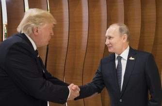 File Photo: US President Donald Trump (L) shaking hands with his Russian counterpart Vladimir Putin.  / AFP PHOTO /