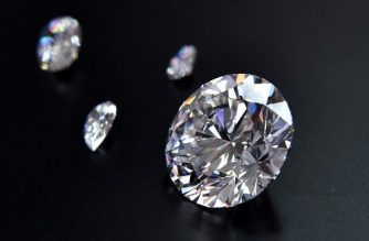 A view of the main 51.38-carat round-cut diamond, the Dynasty, among other gems from Russian diamond miner Alrosa's Dynasty polished diamonds collection in Moscow on August 3, 2017. The collection of five polished stones was manufactured from a 179-carat Romanovs rough diamond, extracted at the company's Nyurbinskaya kimberlite pipe in Russia's far northeast region of Yakutia in 2015. Alrosa plans to sell the whole collection in one set at a special online auction in November with the starting price not less than $10 million, according to the company's CEO Ivanov. / AFP PHOTO / Yuri KADOBNOV