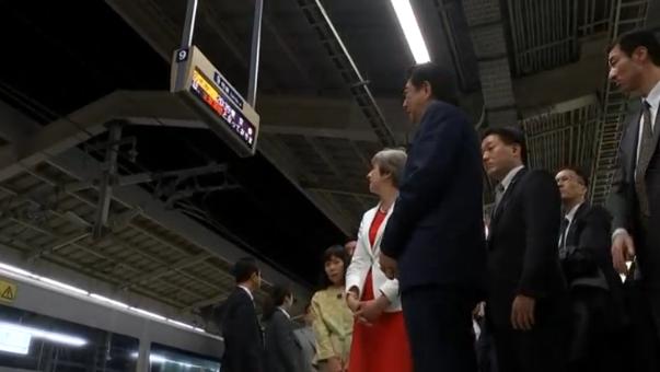 May, Abe board Japanese 'Bullet Train'