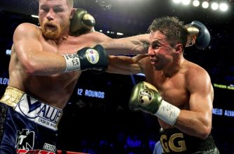 Gennady Golovkin (R) exchanges blows with Canelo Alvarez (L) during their WBC, WBA and IBF middleweight championship fight at the T-Mobile Arena on September 16, 2017 in Las Vegas, Nevada.  Gennady Golovkin retained his three world middleweight titles, fighting to a draw with Mexican star Canelo Alvarez in a showdown for middleweight supremacy that lived up the hype.  / AFP PHOTO / John GURZINSKI