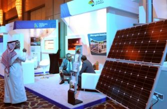 Exhibitors and visitors attend the Saudi Arabia Renewable Energy Investment Forum (SAREIF) on April 17, 2017, in Riyadh. / AFP PHOTO / FAYEZ NURELDINE