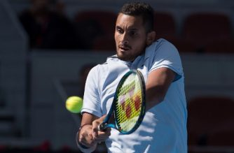 Nick Kyrgios of Aurstralia hits a return during his men's singles match against Mischa Zverev of Germany at the China Open tennis tournament in Beijing on October 4, 2017. / AFP PHOTO / Nicolas ASFOURI